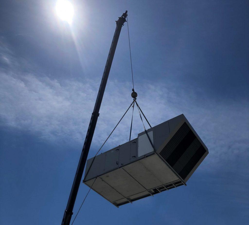 Industrial HVAC unit crane installation